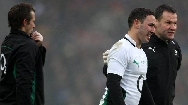 Paddy Wallace leaves the field with an injury