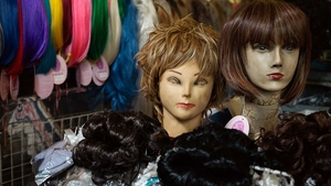 Wigs on display in the central market in Phnom Penh, Cambodia