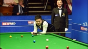 Ding Junhui reacts to his concentration lapse at the Crucible