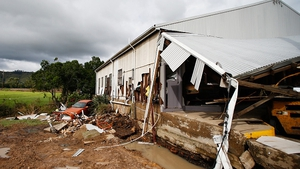 The storm destroyed houses, cut power and caused millions of dollars of damage