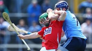 Dublin's Conal Keaney tackles Daniel Kearney of Cork during the AHL semi-final on Sunday