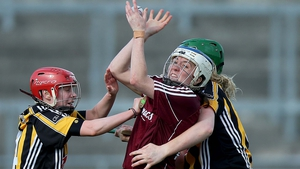 No hurley is no obstacle for Ailish O'Reilly of Galway as she vies with Edwina Keane and Jacqui Frisby of Kilkenny during the Irish Daily Star League Division 1 Semi-Final on Sunday