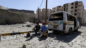 Yemeni deminers collect mines and explosives at the scene of an airstrike allegedly carried out by the Saudi-led coalition