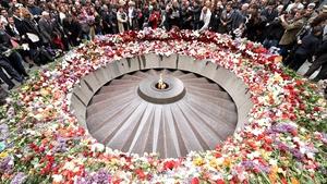 People lay flowers at the Tsitsernakaberd Memorial in Yerevan