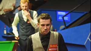 Mark Selby (r) suffered a shock 13-9 loss to Anthony McGill