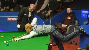 Mark Selby watches on as Anthony McGill builds another break