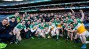Offaly players celebrate with the cup on the Croke Park pitch