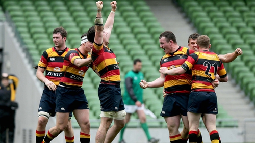 Lansdowne players celebrate scoring a try against Young Munster in the last seconds of extra time