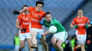 Armagh's James Morgan is tackled by Paul McCusker of Fermanagh