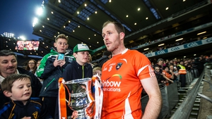 Armagh captain Ciaran McKeever walks past some young Fermanagh fans while holding his newly acquired Allianz Football League Division 3 trophy