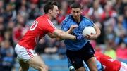 Cork's Kevin O'Driscoll tackles Dublin's James McCarthy