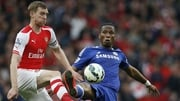 Chelsea's Didier Drogba (R) vies with Arsenal's Per Mertesacker during the game