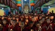 Nepalese novice Buddhist monks who live in the Indian town of Bodh Gaya offer prayers for the victims of the earthquake