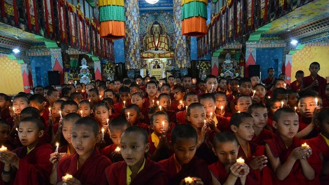 Nepalese novice Buddhist monks who live in the Indian town of Bodh Gaya offer prayers