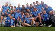 The Dublin team and supporters celebrate with the Division 1 trophy