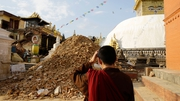 A monk inspects the damage at Nepalese heritage site Swayambhunath Stupa in Kathmandu