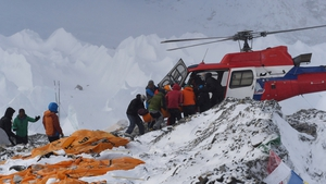 Injured climbers are removed from Base Camp on Mount Everest. 17 people died in an avalanche triggered by the quake