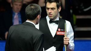 The referee gives out to Ronnie O'Sullivan
