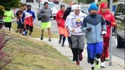 Manny Pacquiao is joined by suporters for his morning jog along a city street to a park in Los Angeles