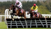 Douvan ridden by Ruby Walsh clears the last fence on the way to winning the Herald Champion Novice Hurdle