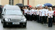 The hearse carrying Karen Buckley's coffin is flanked by nurses from her University of Limerick graduation year
