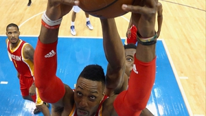Dwight Howard of the Houston Rockets grabs a rebound against Al-Farouq Aminu of the Dallas Mavericks during game four of the Western Conference quarter-finals of the 2015 NBA play-offs at American Airlines Center