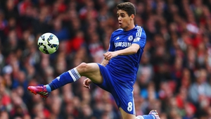 Oscar of Chelsea controls the ball during the Barclays Premier League match between Arsenal and Chelsea at Emirates Stadium