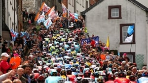 The peloton climb through the town of Houffalize during the 101st Liege-Bastogne-Liege