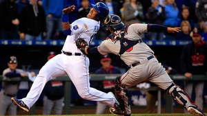 Salvador Perez of the Kansas City Royals is tagged out at home plate by catcher Kurt Suzuki of the Minnesota Twins while trying to score during the second inning of their clash at Kauffman Stadium