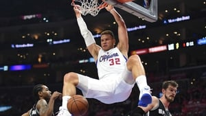 Blake Griffin of the Los Angeles Clippers dunks between Kawhi Leonard and Tiago Splitter of the San Antonio Spurs during game two of the Western Conference quarter-finals of the 2015 NBA play-offs at the Staples Center