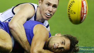 Tom Lynch of the Crows tackles Luke Dahlhaus of the Bulldogs during their round four AFL match at Etihad Stadium