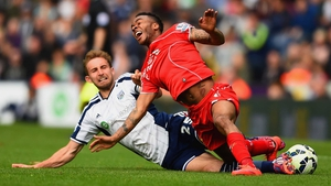 Craig Dawson of West Brom tackles Raheem Sterling of Liverpool during their Barclays Premier League clash