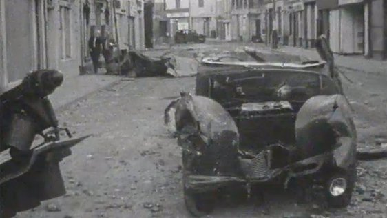 Streets of Derry strewn with rubble, debris and burnt-out vehicles on 14 July 1979.