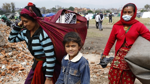 Families return home from tents in the aftermath of the earthquake