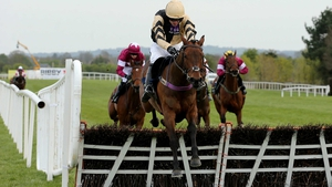 Nichols Canyon ridden by Ruby Walsh clears the last fence on his way to winning
