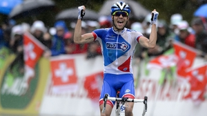 France's Thibaut Pinot, of FDJ cycling team, celebrates after winning the fifth stage of the Tour de Romandie