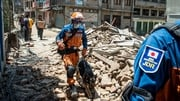 Sniffer dogs and heat-seeking equipment are being used to find survivors in the rubble