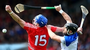 Waterford's Noel Connors and Patrick Horgan of Cork battle for a high ball