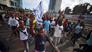 They marched onto the Ayalon highway, a central artery of Israel's commercial capital