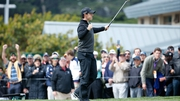 Rory McIlroy celebrates his eagle putt