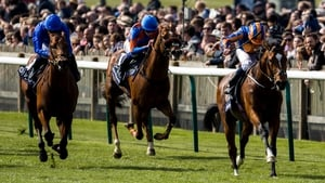 Gleneagles ridden by Ryan Moore leads the field home to win the QIPCO 2000 Guineas Stakes