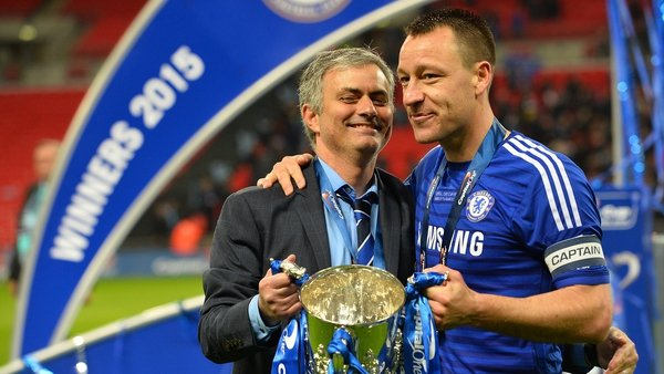 Jose Mourinho in happier times with Chelsea captain John Terry after winning last season's league cup