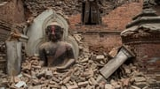 A Buddha statue is surrounded by debris from a collapsed temple in the UNESCO world heritage site of Bhaktapur, Nepal