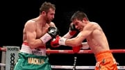 Matthew Macklin (green and gold shorts) in action against Jorge Sebastien Heiland (orange shorts)