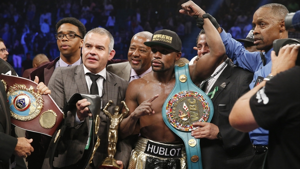 Floyd Mayweather with his WBA and WBC welterweight belts