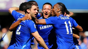 Branislav Ivanovic, John Terry and Didier Drogba celebrate winning the Barclays Premier League title after their 1-0 win over Crystal Palace at Stamford Bridge