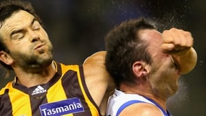 Kangaroos' Todd Goldstein feels the force of the forearm of Jordan Lewis of the Hawks during the AFL match between the North Melbourne Kangaroos and the Hawthorn Hawks at Etihad Stadium in Melbourne