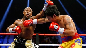 Welterweight king Floyd Mayweather Jr and Manny Pacquiao exchange blows during their bout at MGM Grand Garden Arena in Las Vegas