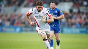 Iain Henderson runs in a try for Ulster against Leinster