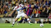 Bayern Munich defender Juan Bernat vies with Lionel Messi